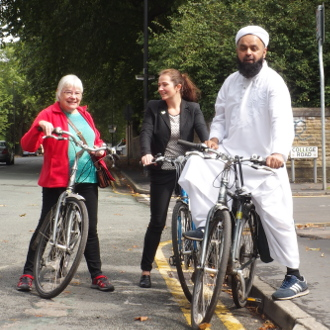 Mary, Angeliki and Aftab cycle on Upper Chorlton Road