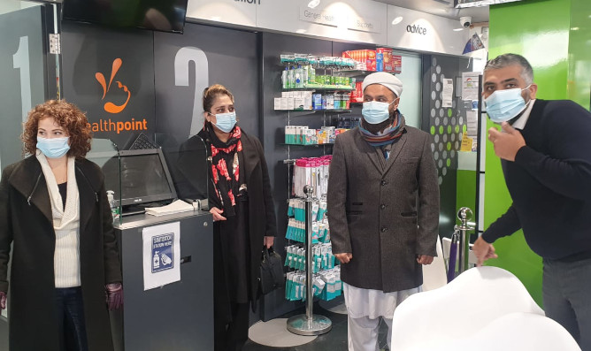 Angeliki, Bano and Aftab are shown the Everest vaccination centre by Mr Waqqass Sheikh